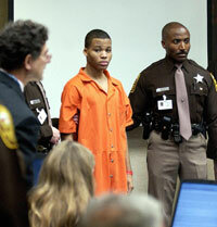 Lee Boyd Malvo is escorted by deputies as he is brought into court to be identified by a witness.