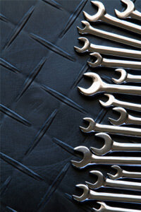 A good set of wrenches is essential for most basic brake line repair.