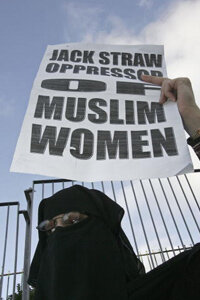 A Muslim woman protests British politician Jack Straw's statements about the burqa.