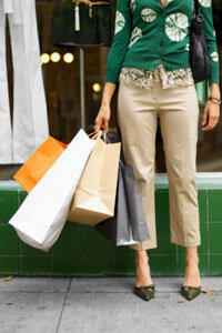 This shopper could very well be on a lunch break from her business casual workplace judging by her demure cardigan, pressed khakis and kitten heels.