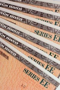 The government began phasing out all paper bonds, like these Series EE Savings Bonds, in favor of electronic bonds sold through TreasuryDirect.gov. See more investing pictures.
