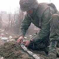 A U.S. Army officer plants 14 pounds of C-4 explosive on a command bunker in Bosnia-Herzegovina.