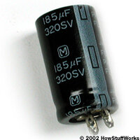 Flash capacitor from a point-and-shoot camera. Take the capacitor quiz to learn more.