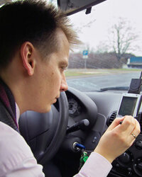 A man setting the destination on his navigation system.