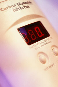 A carbon monoxide detector with a digital display.