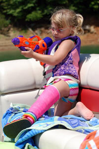 You can't keep a kid down for long -- even if she's got a broken leg.