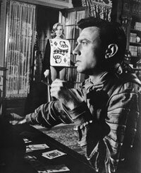 "Laurence Harvey as Raymond Shaw, a former POW who's been brainwashed into an unwitting assassin in the 1962 thriller, ""The Manchurian Candidate."""