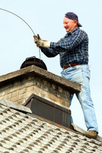 "Is this chimney sweep humming ""Chim Chim Cher-ee"" to himself while he cleans?­"