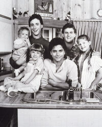 "A very early shot of the ""Full House"" cast -- check out baby Mary-Kate or Ashley Olsen -- in their kitchen.  Somehow 3 bachelors and 3 little girls managed to keep that place spotless!"