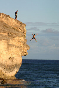 Image Gallery: Extreme Sports Always enter the water feet first when cliff diving. See more pictures of extreme sports.