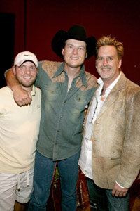 Tour managers ensure tours run smoothly. Here Tour manager Brian Pimmon, left, chats with musician Blake Shelton, center, and Brian O'Connell, right.