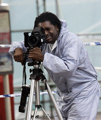 A forensic photographer captures images in London after a 2005 bus bombing.