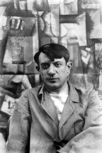 "Pablo Picasso poses with his canvas, ""The Aficionado,"" in the summer of 1912."