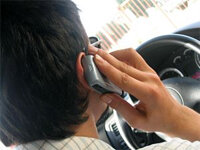 When we're on a cell phone and driving, our attention is divided. Déjà vu may work the same way.