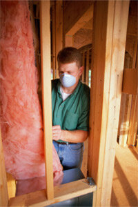 Unlike this guy, you probably want to wear gloves if you're going to install fiberglass insulation.
