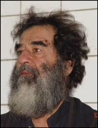 A handout photo of Saddam Hussein after his capture, December 2003