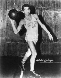 "Schayes was rejected by the U.S.  Army in 1950 because he was one inch taller than the admissible height of 6'7"". See more pictures of basketball."