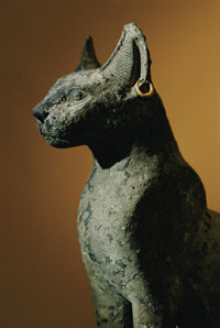 An Egyptian statue of a cat. The statue was uncovered from the ruins of Bubastis.