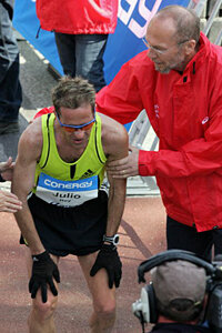 An exhausted Julio Rey finishes the Hamburg Conergy Marathon in Germany on April 27, 2008.
