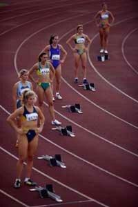 Runners start races at staggered positions for the same reason that motorized wheels require differentials.
