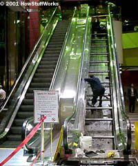 The steps of an escalator ride on a rotating chain assembly.
