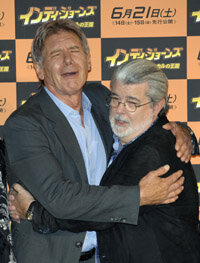 """Indiana Jones"" executive producer George Lucas, right, poses with star Harrison Ford at a recent premiere."
