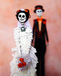 Try taking photos of traditional Day of the Dead artwork, like the Mexican wedding figurines shown here.