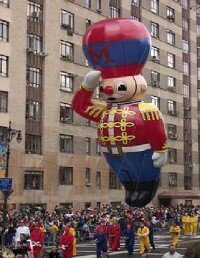 Macy's Thanksgiving Day Parade draws                                  thousands to New York City.
