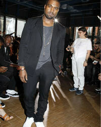 Kanye's sneakers are a staple of his wardrobe, and he frequently pairs them with dress pants and suits.