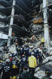 Search and Rescue workers gather at the scene of the Oklahoma City bombing.
