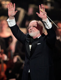 """John Williams was responsible for many memorable scores including the original """"Star Wars"""" trilogy and """"Jaws."""" He performed at the """"Movies Rock"""" celebration."""