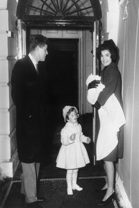 Jackie Kennedy, shown with her family at the White House in 1961, was so well-loved by the press and the public that she hired a press secretary to handle the media attention.