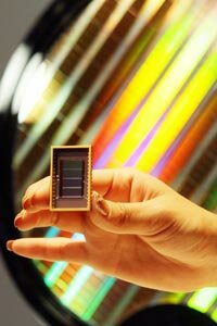 Samsung Electronics shows off the world's first 30-nanometer 64-gigabit Flash memory device.