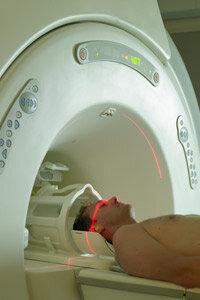 An MRI machine aims radio waves at the body.