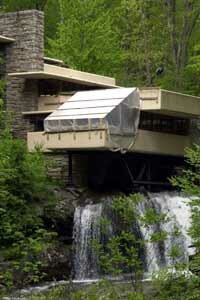 A picture of Fallingwater undergoing restoration in order to preserve the home.
