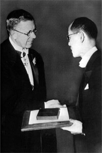 Dr. Hideki Yukawa, right, receives the Nobel Prize for physics in Stockholm from then Crown Prince Gustaf Adolf of Sweden Dec. 10, 1949, for his postulation on the meson.