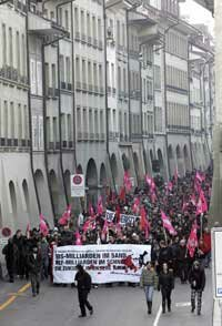 Anti-globalization protestors march through the Swiss town of Bern.