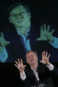 Google CEO Eric Schmidt delivering an animated speech about search engine strategies.