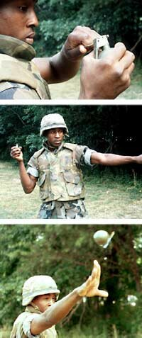The proper way to throw a hand grenade: Depress the striker lever, pull the pin, hurl the grenade.