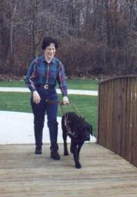 A Guiding Eyes for the Blind graduate with her guide dog