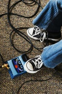 An array of pedals can turn the clean and sometimes thin sound of an electric guitar into something wild and distorted.