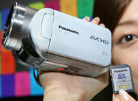 This high-definition digital video camera captures images onto a memory card.