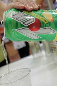 """The makers of 7Up, which includes high-fructose corn syrup as an ingredient, dropped their claim that the product was """"all natural"""" after being threatened with a lawsuit by a consumer advocacy group."""