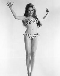 Itsy-bitsy for sure. Julie Newmar models the suddenly de rigueur bikini in the 1960s.