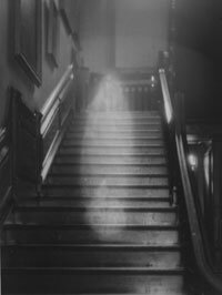 """The famous 1936 photo of the """"Brown Lady"""" descending the staircase at Raynham Hall in Norfolk, England."""