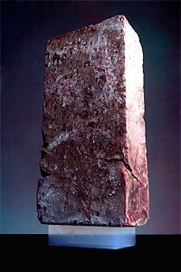 A 5.5 pound brick is supported by a piece of silica aerogel weighing only 2 grams (0.07 ounces).