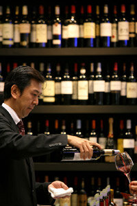 A sommelier pours a bottle of wine during the World Summit of Gastronomy. See more wine pictures.