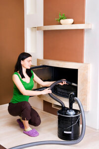 Vacuuming the fireplace is a good spring cleaning task.