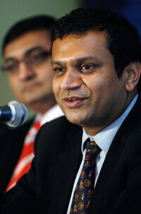 Morgan Stanley India Vice President Jayesh Gandhi (L) looks on as Country Head Narayan Ramachandran (R) speaks during a press conference to announce the launch of their new mutual fund in Mumbai, on February 7, 2008.