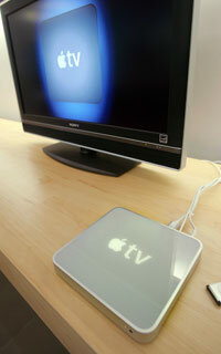 The Apple TV wirelessly connects computers to televisions and displays videos from iTunes.